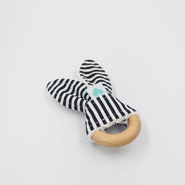 baby teether in black and white stripes fabric