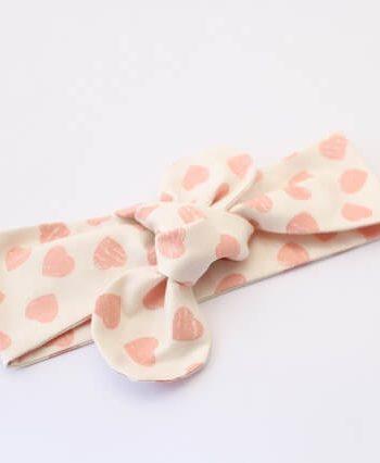hair bun in pink hearts fabric topknot