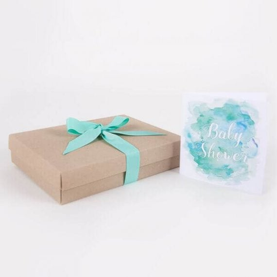 Cardboard gift box with mint colour ribbon and baby shower card