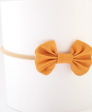 baby bows in mustard fabric