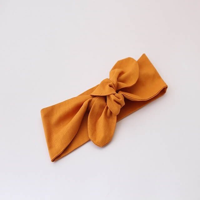 baby top knot headband in mustard print
