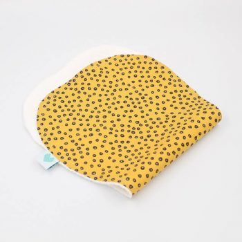 girl burping towel in spots in gold print