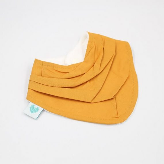 Soft bibs in mustard colour