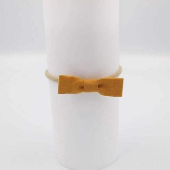 Fabric baby bows in mustard colour