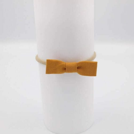 Fabric newborn bows in mustard colour