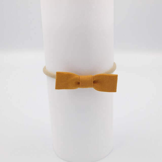 Baby bows in mustard
