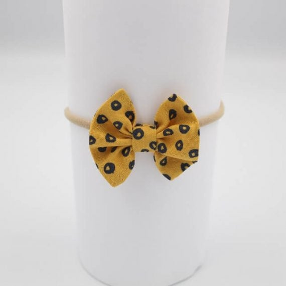 Boutique hair bows in gold colour with black spots
