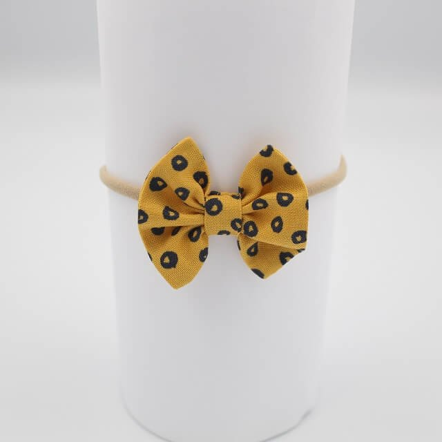 Boutique hair bows in spots on gold