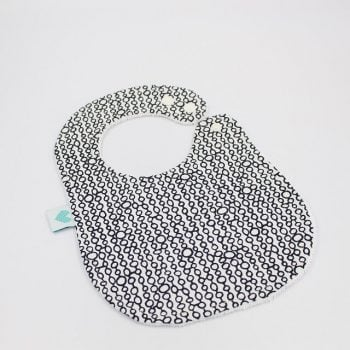Baby bib with black circles print on white background