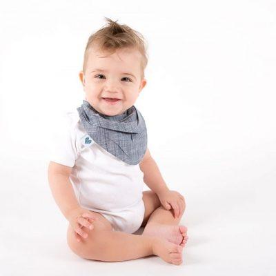 Boy wearing indigo dribble bib