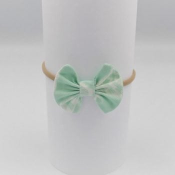 infant hair bows in aqua with white feathers