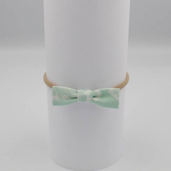 girls bow headbands in aqua print with white feathers