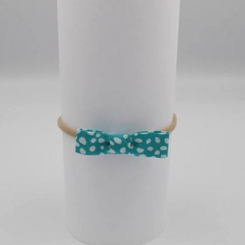 Aqua print with white dots on a mini hair bow