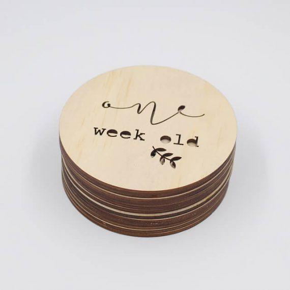 one week old milestone plaque