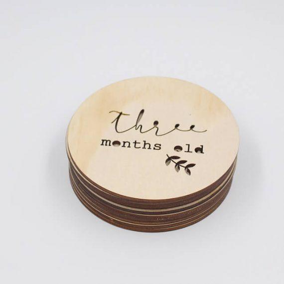 three months old wooden milestone plaque