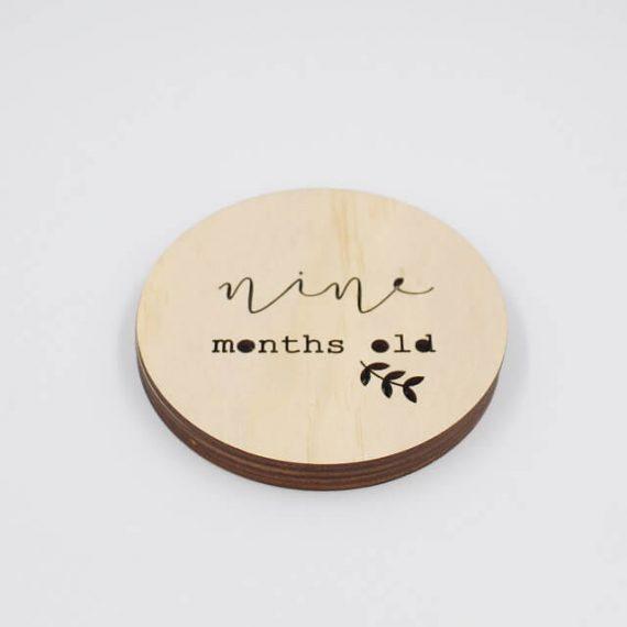nine month old wooden disc