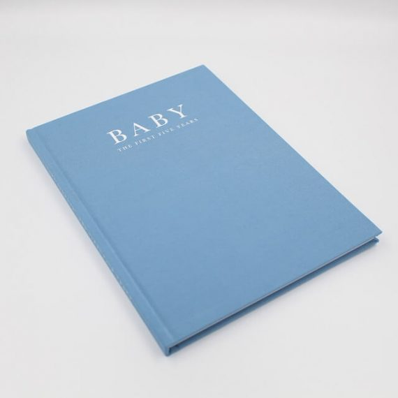 Baby memory book in blue with the first five years inscribed